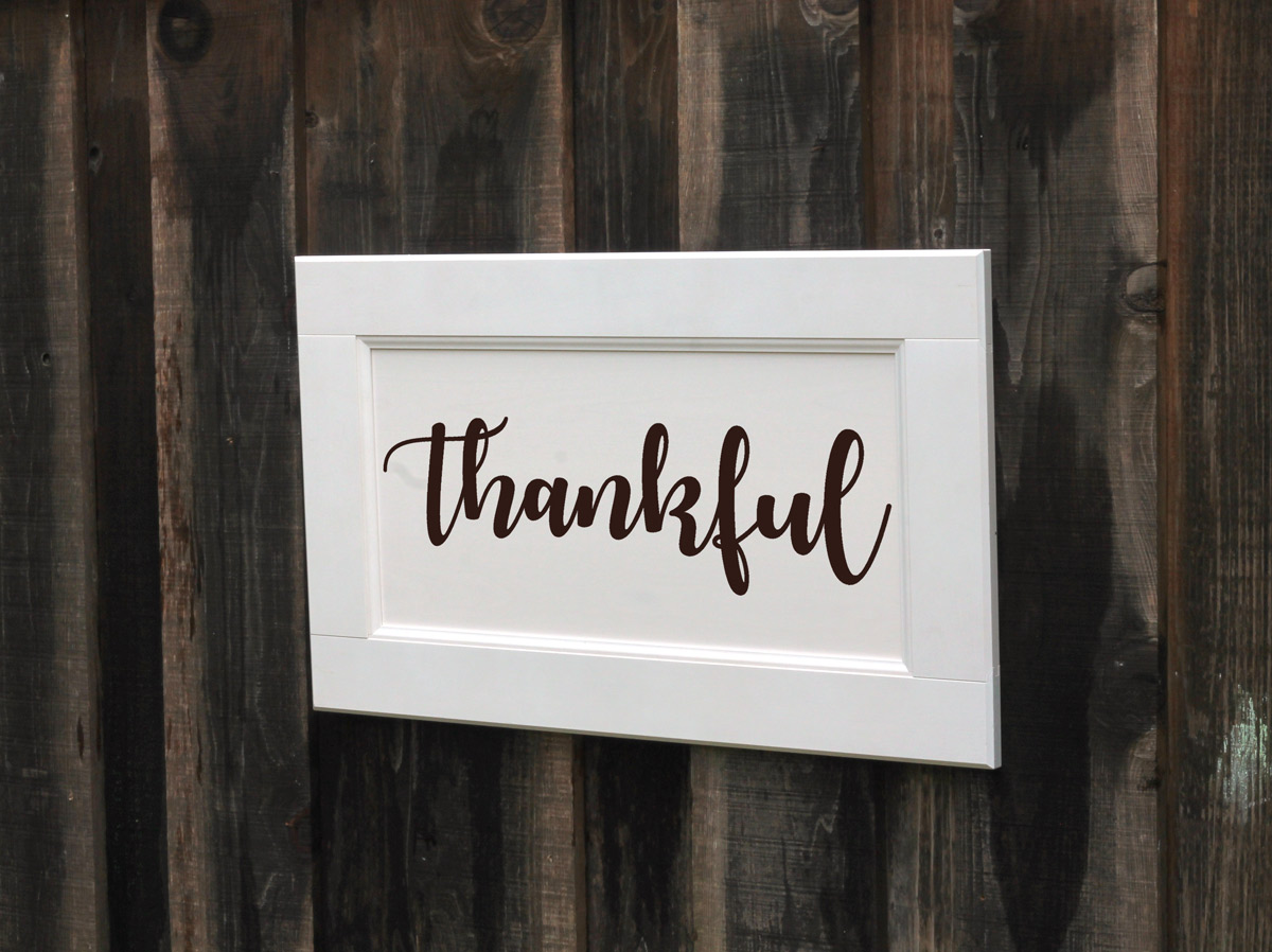 Thankful sign from cabinet door