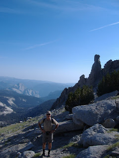 P at the base of the summit dome, with Half Dome in the background.