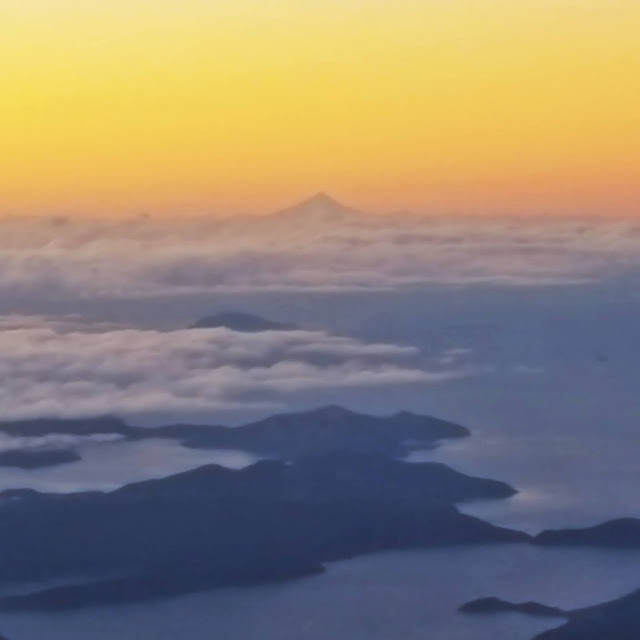 Sunrise from a plane above Aotearoa / New Zealand