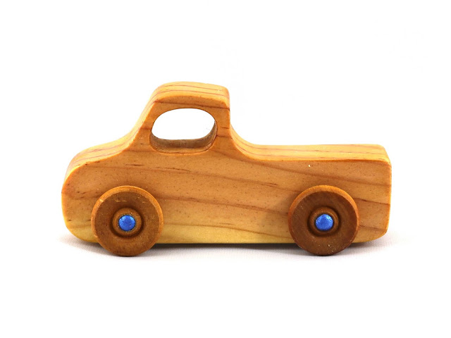 Handmade Wooden Toy Pickup Truck from the Play Pal Series Pine Amber Shellac With Metallic Blue Hubs