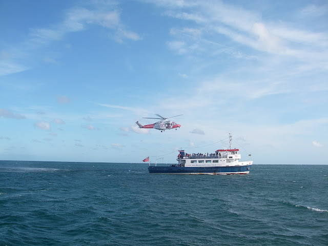 4 September 2011 - Portland Coastguard about to winch a winchman down to the passenger ferry Jurassic Scene to airlift a casualty with chest pains to Dorchester Hospital. Photo: RNLI/Poole lifeboat