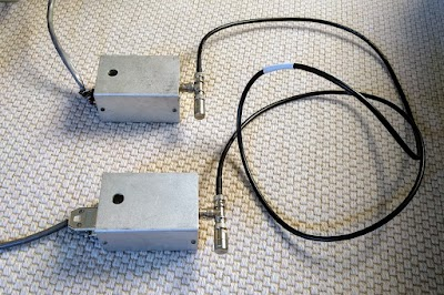 A very short 3 Mb/s Ethernet network, showing two transceivers attached to the coaxial cable. One transceiver is connected to the Alto and the other is connected to the LCM+L gateway card.