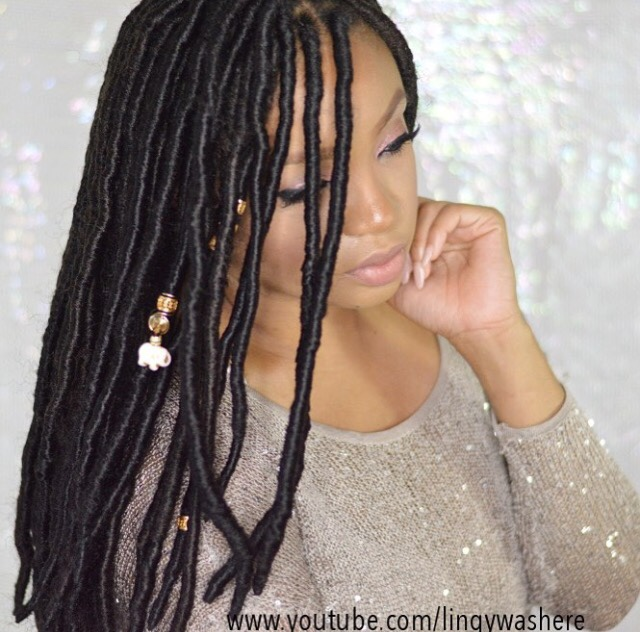 girl with black faux locs and gold beads
