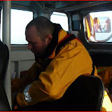 New trainee Steve Dow checking over the navigation area of the Tyne class lifeboat Photo (from video): RNLI/Anne Millman