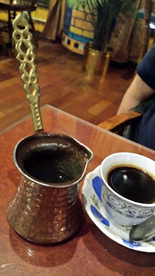 Arab Coffee: Rich, thick and dark coffee, with a hint of cardamom sweetness, served in authentic Iraqi sipping glasses. Refills available.