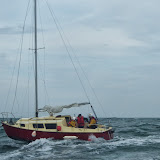 Two RNLI crew members onboard the yacht to assist its sole occupant - 28 September 2013. Photo credit: RNLI / Rob Inett