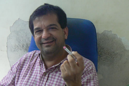 """Humsafar drop-in center director Vivek holding his """"one vice""""."""