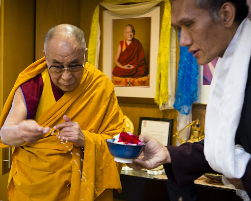 His Holiness the Dalai Lama blessing objects in FPMT International Office board room with Yangsi Rinpoche, Portland, Oregon, U.S., May 10, 2013. Photo by Leah Nash.