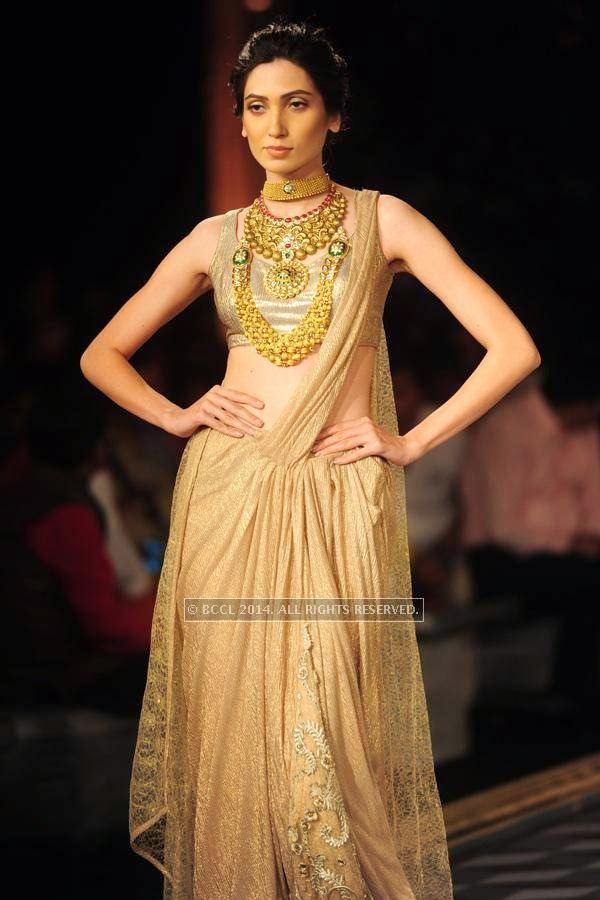 A model walks the ramp for Shree Raj Mahal Jewellers on Day 6 of India Couture Week, 2014, held at Taj Palace hotel, New Delhi.