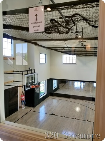 indoor basketball court with retractable batting cage
