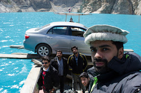 Crossing Attabad Lake on boat.