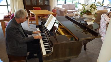 Claude Moffat playing Park Lane Village's Schimmel grand piano.