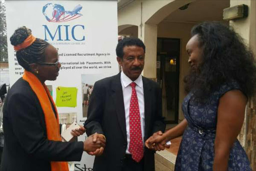 Eritrean ambassador Beyene Russom {n red tie} with Margaret Ikua{R} of Magtech Inspiration Centre and Jane Muigai director of toolkit Institute after signing a deal yesterday to recruit Kenyan lecturers to work in Eritrea