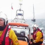 Another shot of the ILB crew towing the 8m yacht, which had a rope caught round its propeller.  You can see Handfast Point (Old Harry's Rock) in the background - 23 July 2013.  Photo credit: RNLI/Poole