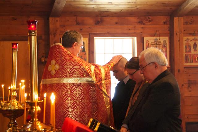 Fr. John prays over each candidate.