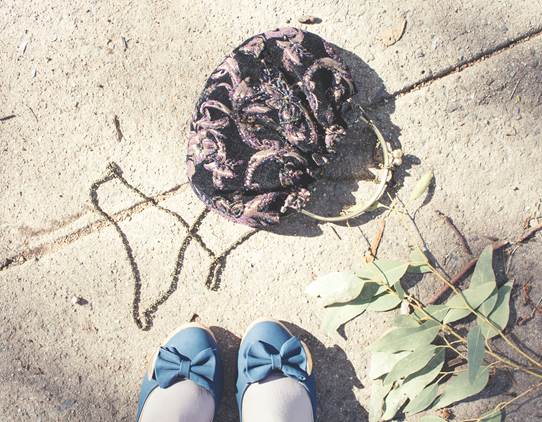 Gum leaves, a beaded purse, and shoes with bows on them | Lavender & Twill