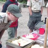 Alex blowing out the candles on his Birthday Cinnamon Rolls....freshly baked in camp that morning