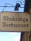White Shakesby's black & white Restaurant sign in lite gothic script