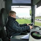 ik achter het stuur van de bus van pouw