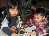 An adorable brother and sister at the coloring station