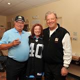 Mr. & Mrs. Marvin Sindel, winners of Banaszak autographed Oakland Raiders jersey