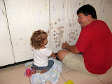 Mollie helping daddy scrape before painting