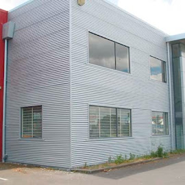 This cladding was painted with an Acrylic Metallic Coating to imitate the existing Lucabond Aluminium cladding.
