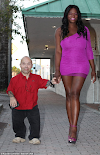 Record-breaking dwarf bodybuilder finds love with 6'3'-tall transgender woman