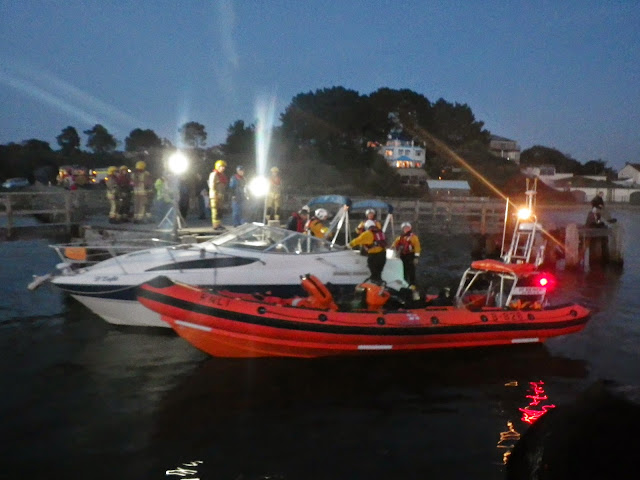 The ILB crew secure the motor cruiser at Lake Pier, where fire crews are waiting to inspect the vessel - 31 October 2014. Photo credit: Dave Riley