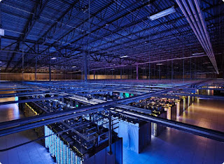 Interior of a Google Cloud data center showing multiple rows of servers from above.