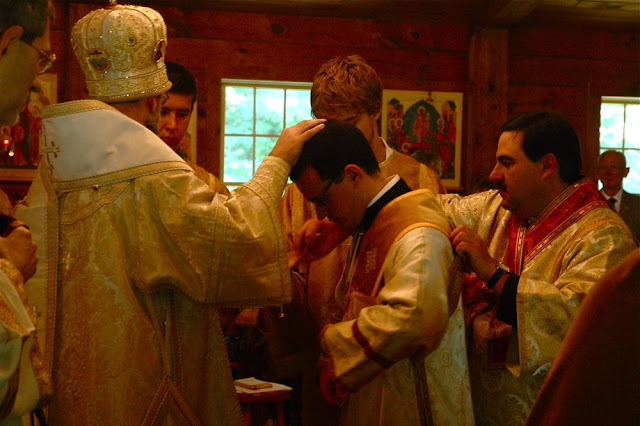During the sixth hour, Reader Nilus is brought before the bishop to be ordained to the rank of Subdeacon.  He is invested with the orarion, which represents the angelic wings of the diaconate ministry.