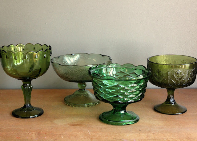 Medium green pedestal bowls available for rent from www.momentarilyyours.com, $2.00 each.