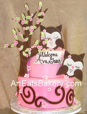 Two tier pinkand brown fondant custom baby shower cake with sugar owls, flowers and tree