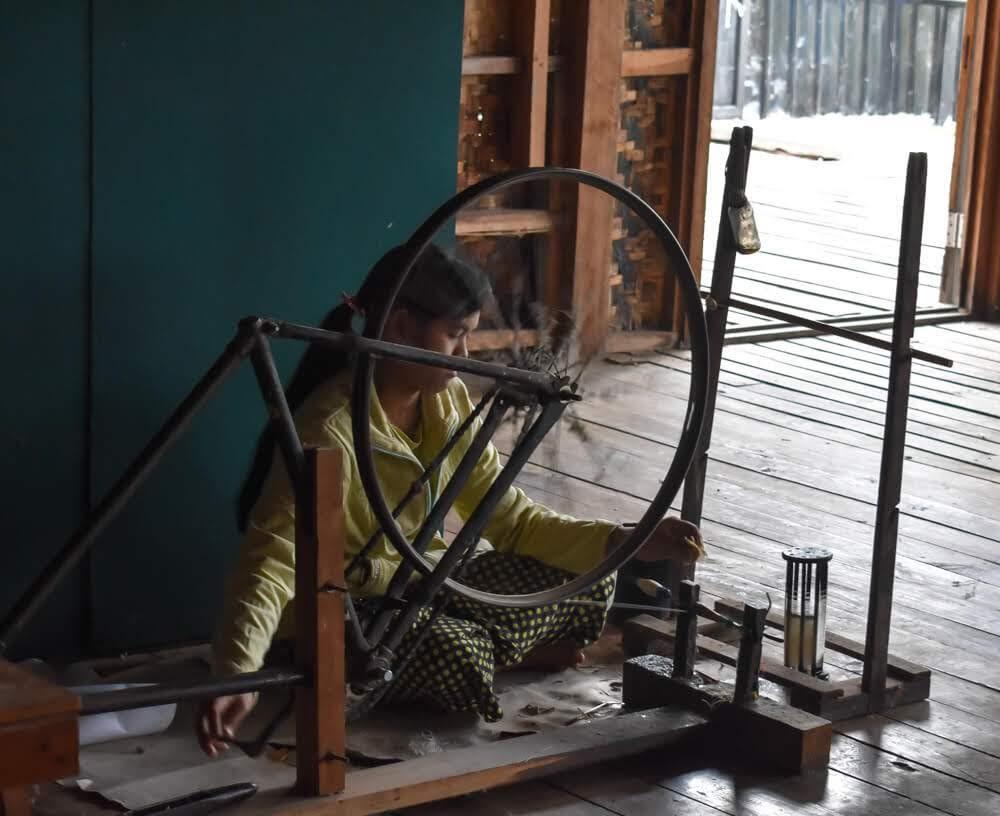 Lake+Inle+Burma+lotus+weaving+center+woman+with+spin+wheel.jpg