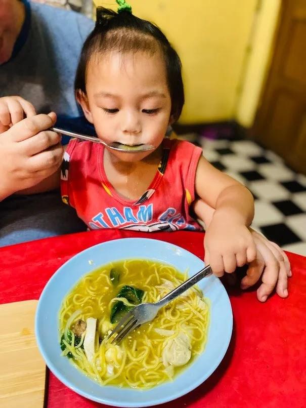Our baby enjoying Mack Nam's beef mami