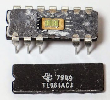 The TL084 op amp. The ceramic package has been opened, exposing the die inside. A couple pins fell off when the package was opened.