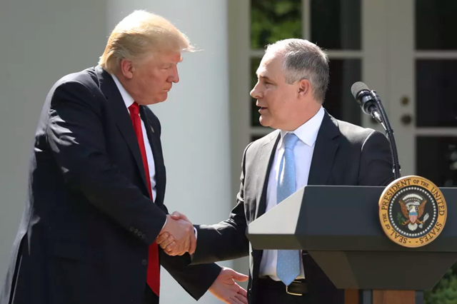 Trump shakes hands with EPA Administrator Scott Pruitt, who is tasked with dismantling the EPA in secret. Photo: Andrew Harnik / AP Photo