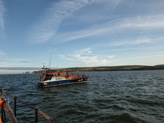 16 July 2014 - Swanage ALB alongside a 7m day boat with engine failure in Poole Bay. Poole ALB coming alongside to take over the tow.  Photo: RNLI Poole/Dave Bursey