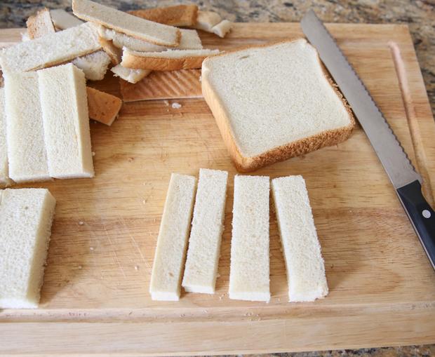 overhead photo of sandwich bread sliced into sticks