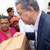 Leonel entrega cajas navideñas en Santiago