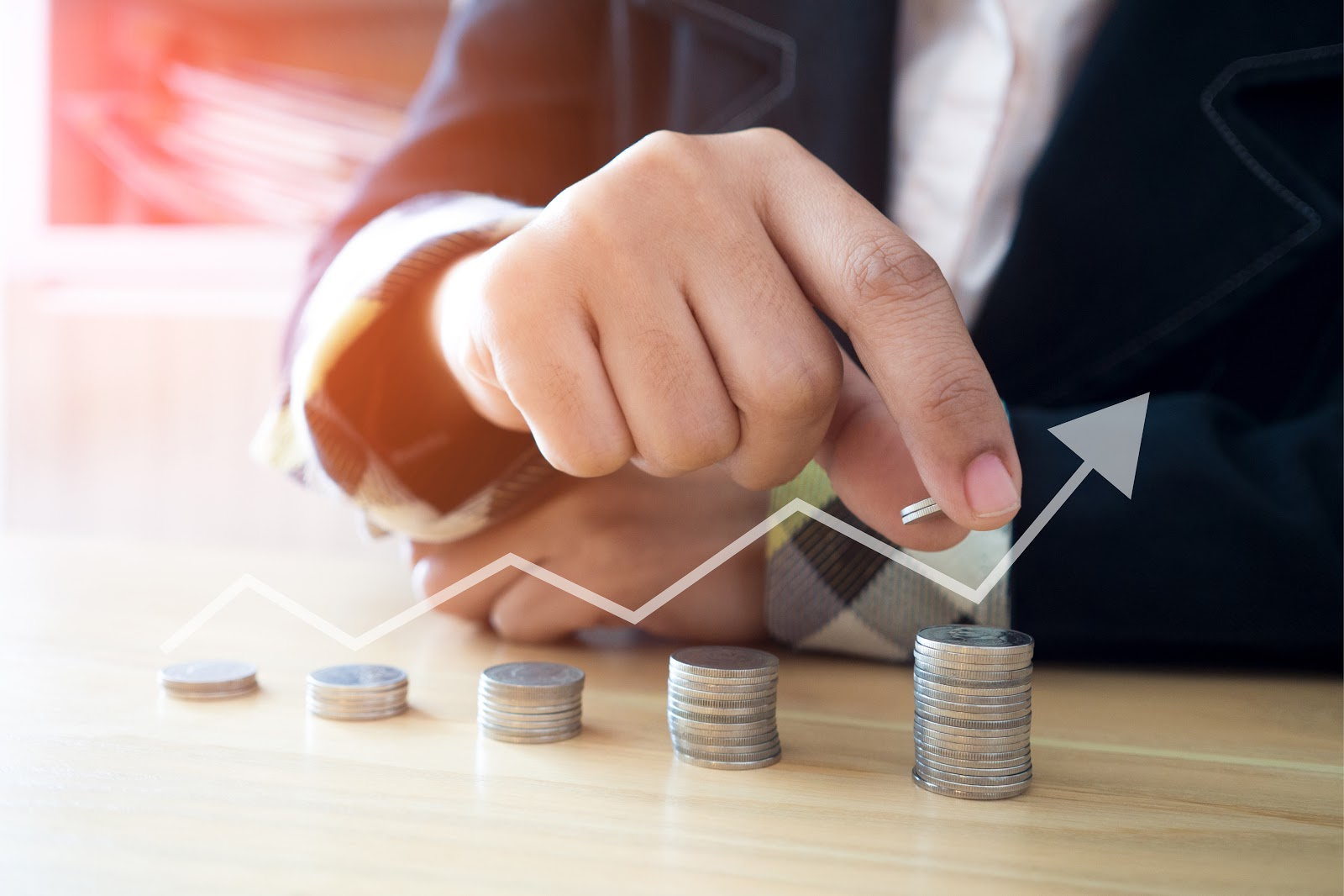 buying a call option: man stacking coins