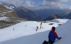 postcard-beauty of the Alps aside, kindly note that in Austria the snowboarders don't camp out mid-run.... that's strong magic is what that is
