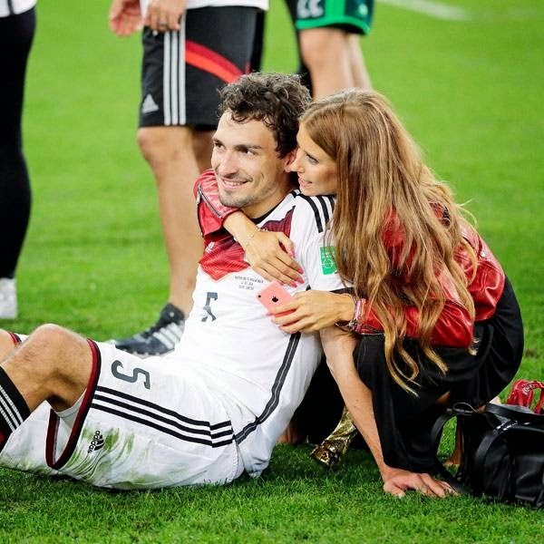 Germany's Mats Hummels is embraced by his partner Cathy Fischer after the World Cup final soccer match between Germany and Argentina at the Maracana Stadium in Rio de Janeiro, Brazil, Sunday, July 13, 2014.