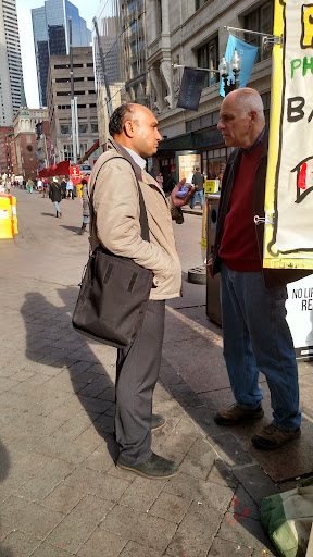 It was a warm day so we went outside. This is Saheem, a Pakistani Muslim who was very interested in talking with Eric. He took a gospel tract in his native Urdu language.