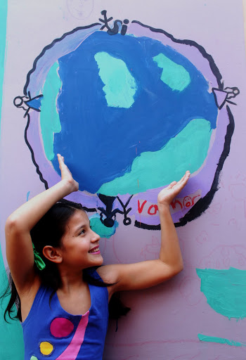 """World's Experts in Childhood Creativity to Gather For World Festival of Children's Theatre. Photo from the Axioma Theatre in Asunción, Paraguay. The child is from the cast of """"Todo Vive"""" - """"Everything Lives"""""""