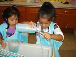 Children involved in exploring water motion.