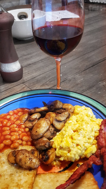 Fried English breakfast and a glass of red wine