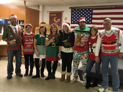 There is the crew with the spirit- all entered in the ugliest Christmas sweater contest