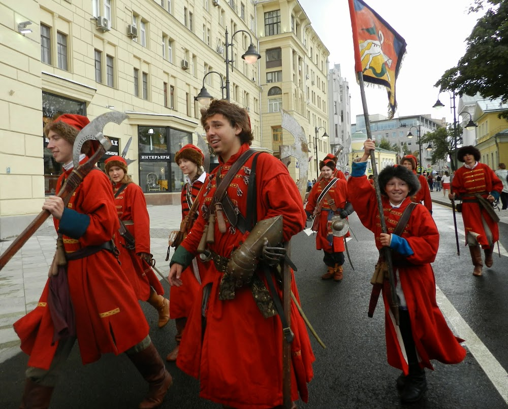 boys dressed as old-school soldiers joyfully parade down the street