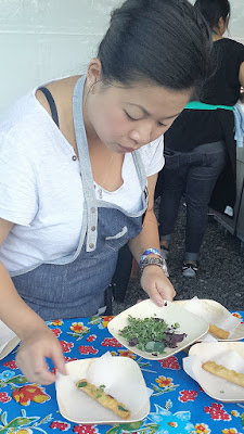 Mei Lin was hyperfocused and zen as she carefully plated her Pork Belly Pâté Egg Rolls, Nước chấm, Fragrant Herbs